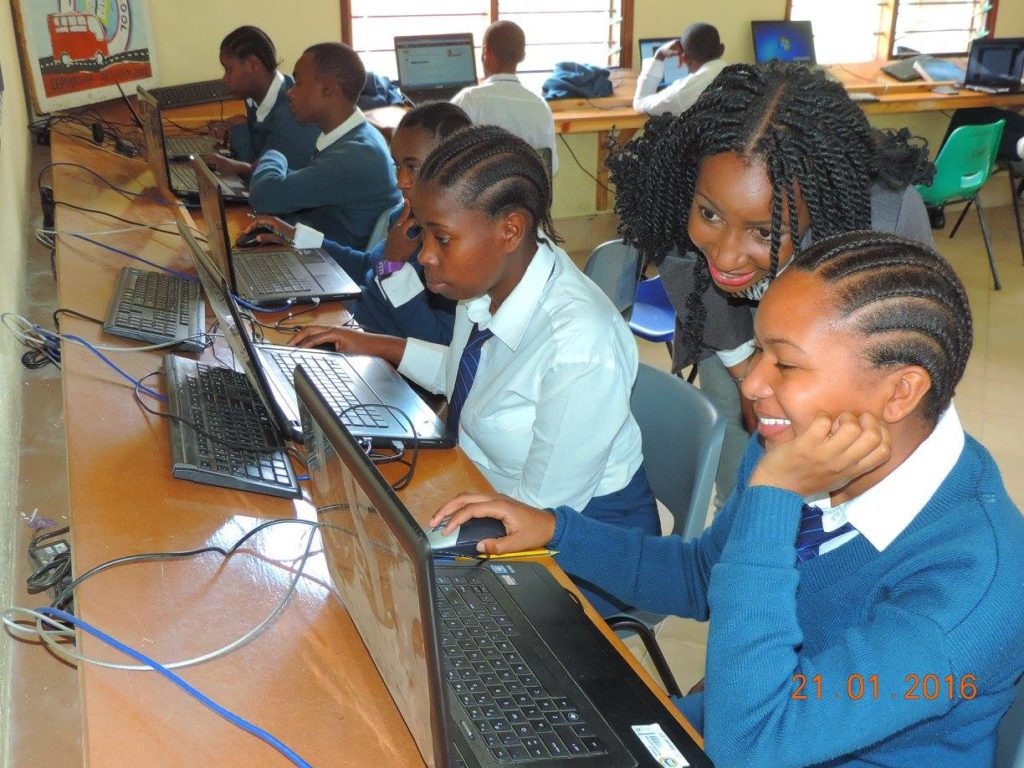 Faraja Nyalandu assists a school girl using Shule Direct platform