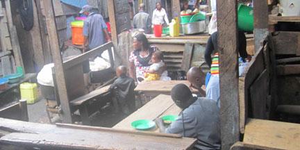 Women at their make shift restaurants in Kamwokya. A kampala surburb. (Photo Eriosi Nantaba)