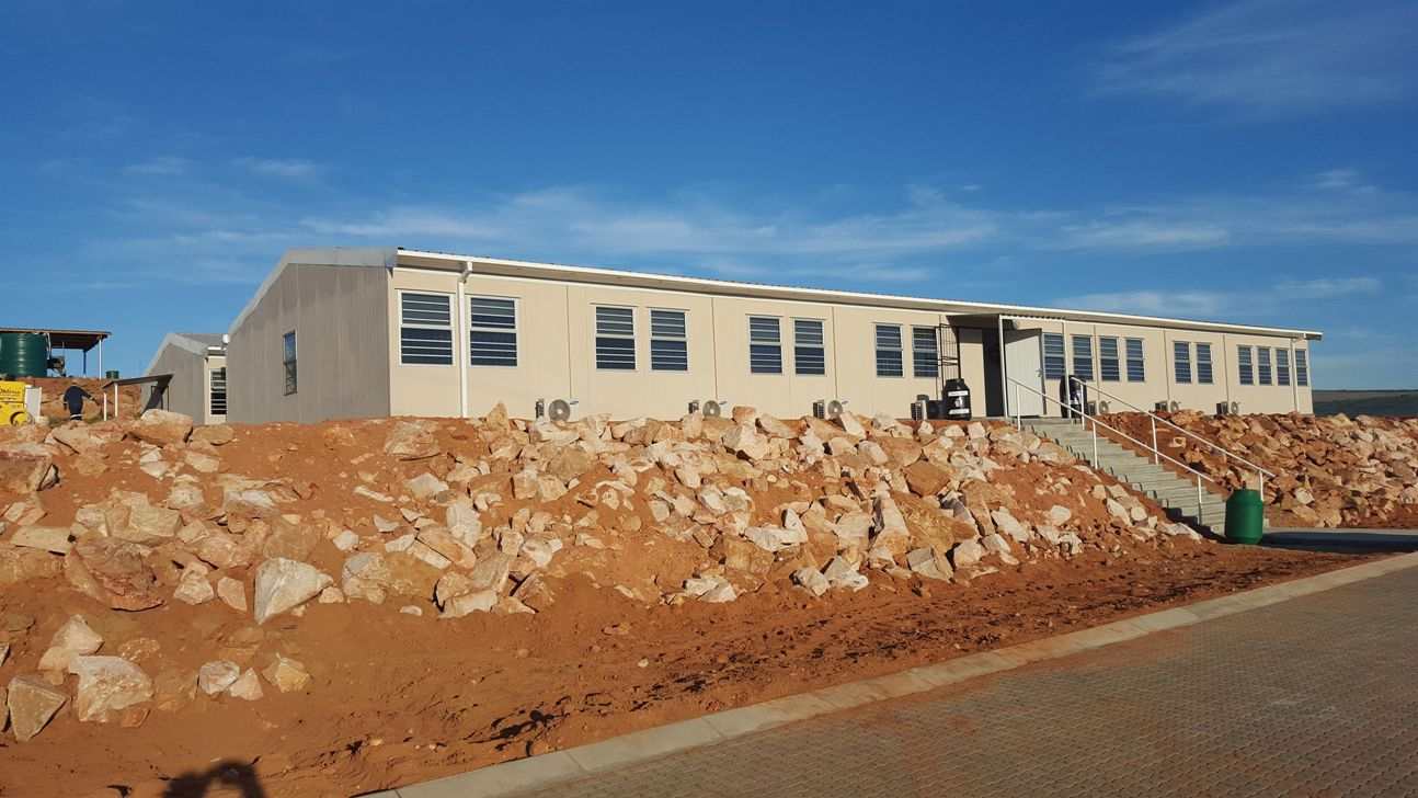 Modular building company contributes to major South African dam wall project through the construction of fire retardant buildings