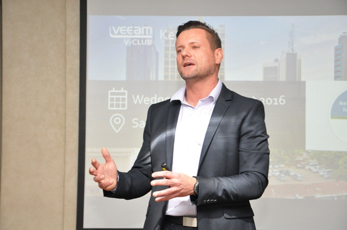 Claude Schuck, Regional Manager for Africa at Veeam welcoming participants of Veeam's V-Club event held in Nairobi.