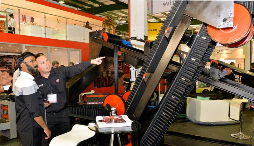 EMA 2014 - (HR) - engaged in a technology discussion during demonstration of machinery
