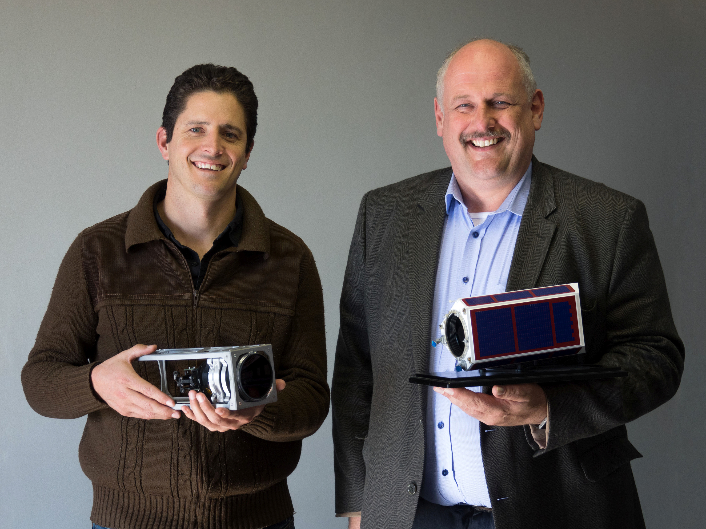 Bryan Dean, systems engineer and Dr. Sias Mostert, Executive Chairman of SCS Aerospace Group show off some of their satellite component models to be displayed and demonstrated at the International Astronautical Congress in Guadalajara, Mexico from 26 – 30 September.