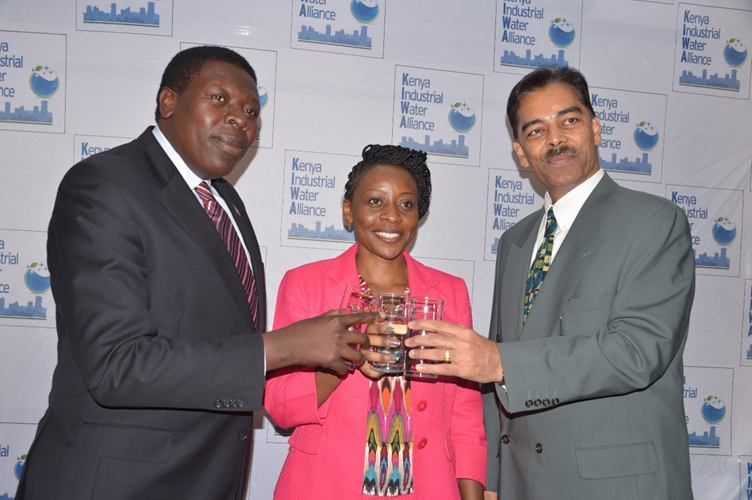 Cabinet Secretary, Kenya Ministry of Water and Irrigation, Eugene Wamalwa, KIWA Chair and CEO of Kenya Association of Manufacturers, Phyllis Wakiaga and Vimal Shah, CEO of Bidco Group toast glasses of water at the launch of the Kenya Industrial Water Alliance (KIWA)