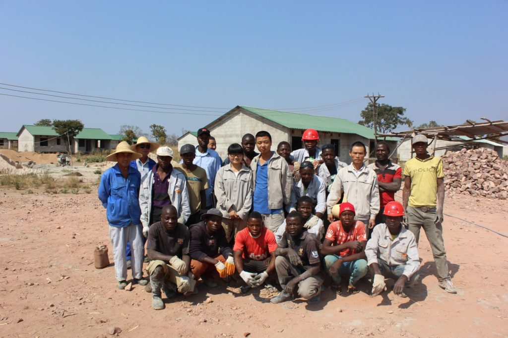 Chinese and Zambian workers on a housing project site in Nsama in the Northern Province. PICTURE: HUMPHREY NKONDE