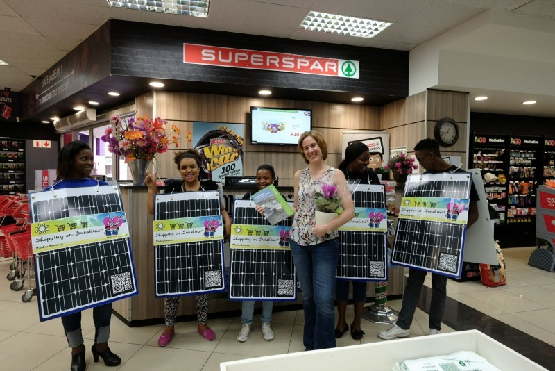 Photo credits to Greenpeace/ Shayne Robinson; Greenpeace activists  displaying shopping on sunshine placards at Spar.